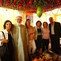 sukkot 2018 family beneath sukka